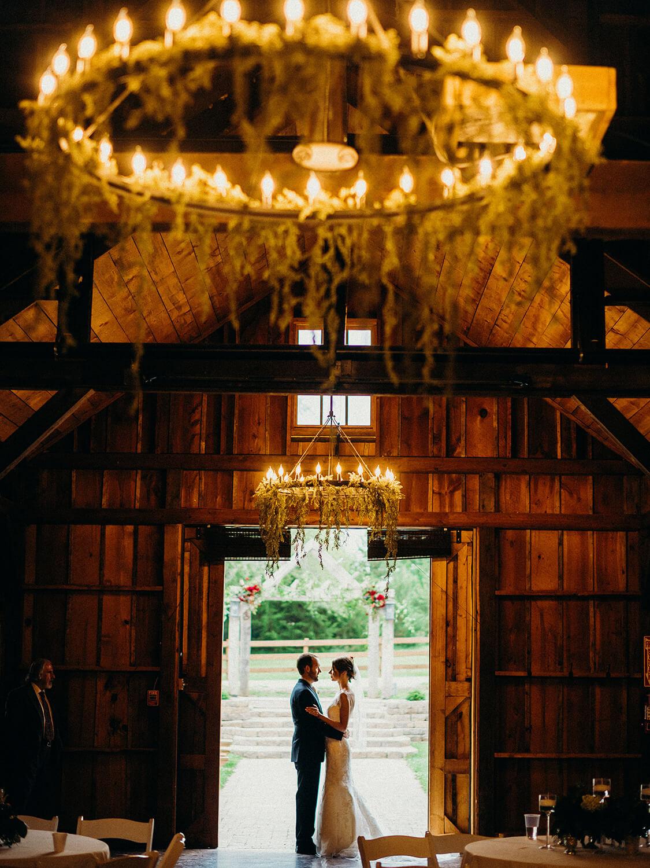 couple greenery chandelier dana Osborne design