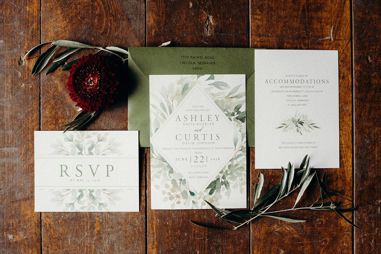 dana osborne design wedding invitation greenery