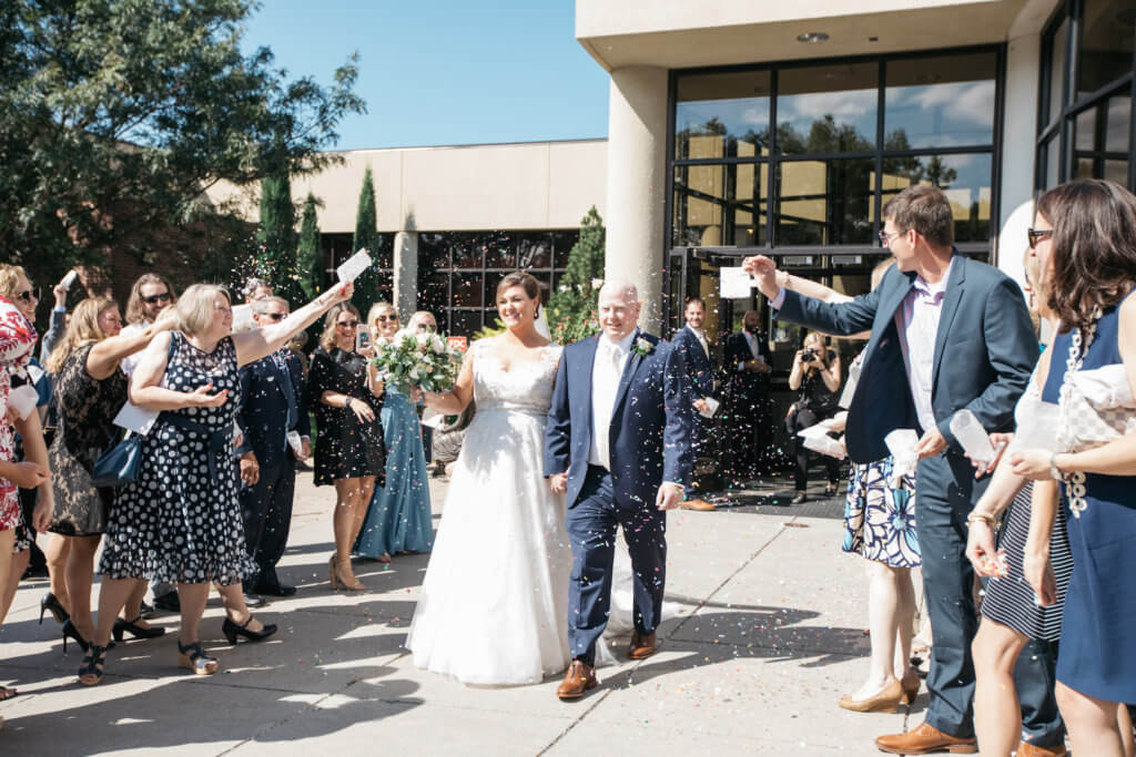couple exit wedding st. roberts omaha dana osborne design