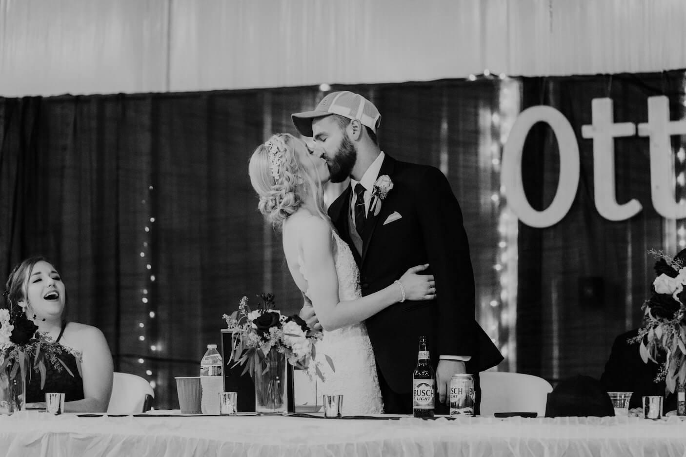 Wedding reception kiss