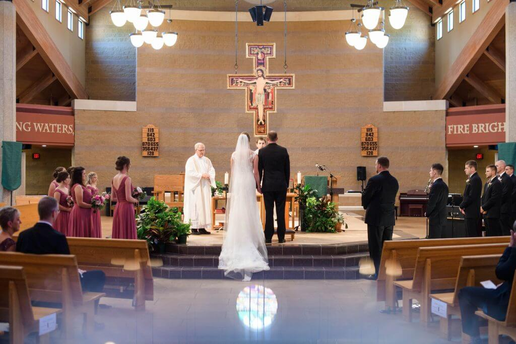 . Francis of Assisi Catholic Church Des Moines, Iowa Wedding.  Wedding invitations by Dana Osborne Design.