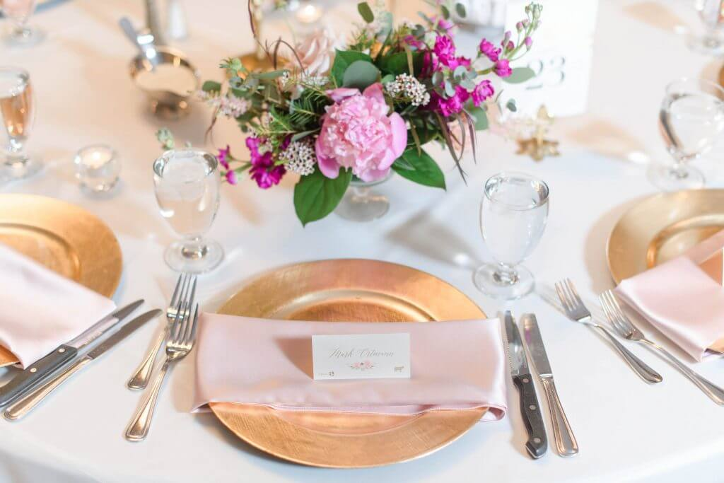 Peony wedding table at a Des Moines, Iowa Wedding. Place cards by Dana Osborne Design.