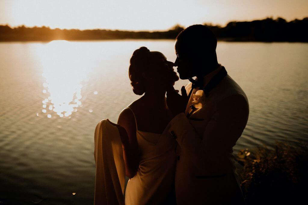 Lakeside wedding photos.  Outdoor wedding Omaha Nebraska.  Invitations by Dana Osborne Design.