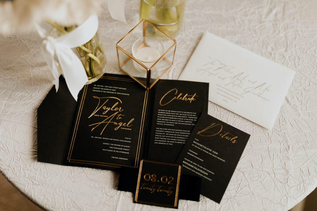 Black pocket wedding invitations with gold foiling.  Velvet wedding invitation band.  www.danaosbornedesign.com